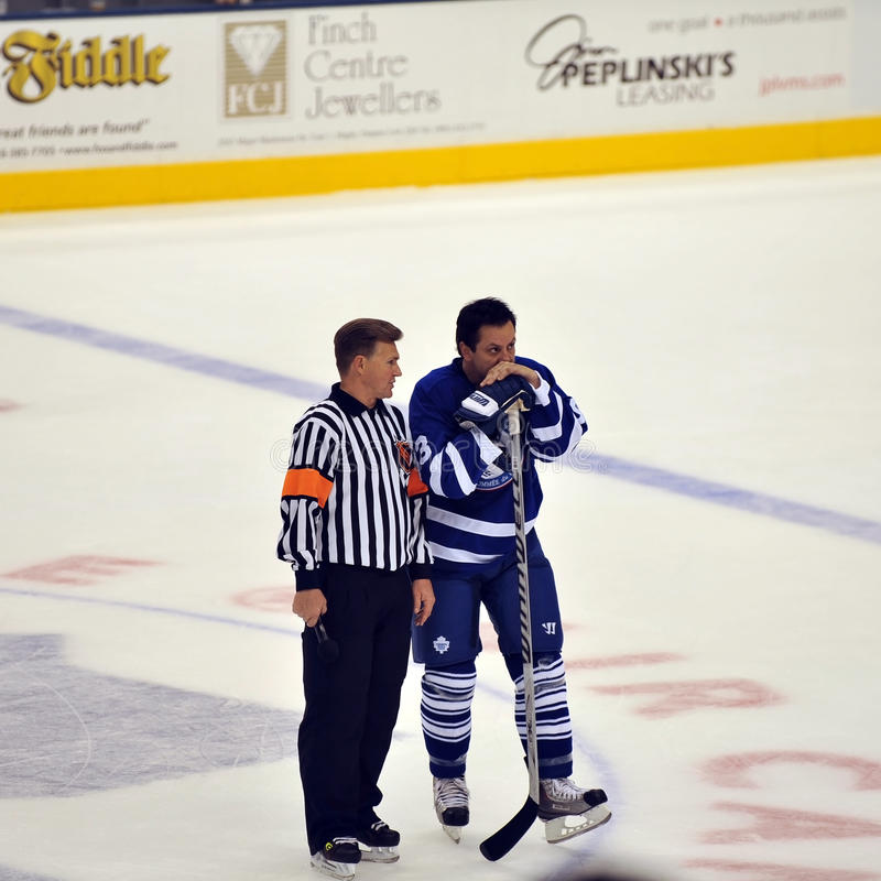 Kerry Fraser with Doug Gilmour. Referee Kerry Fraser talks to Hall of Famer Doug Gilmour during Hockey Hall of Fame Legends Classic game Air Canada Centre Nov 13 royalty free stock images