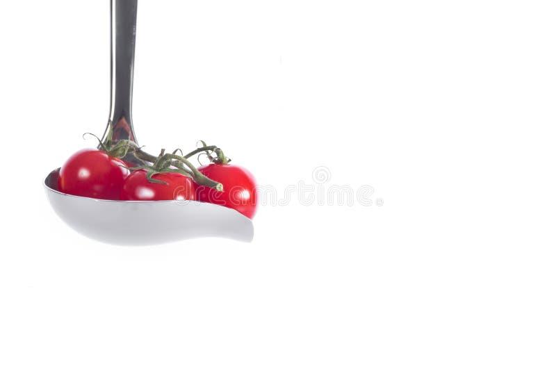 Kers tomat in sausbestek royalty-vrije stock afbeelding