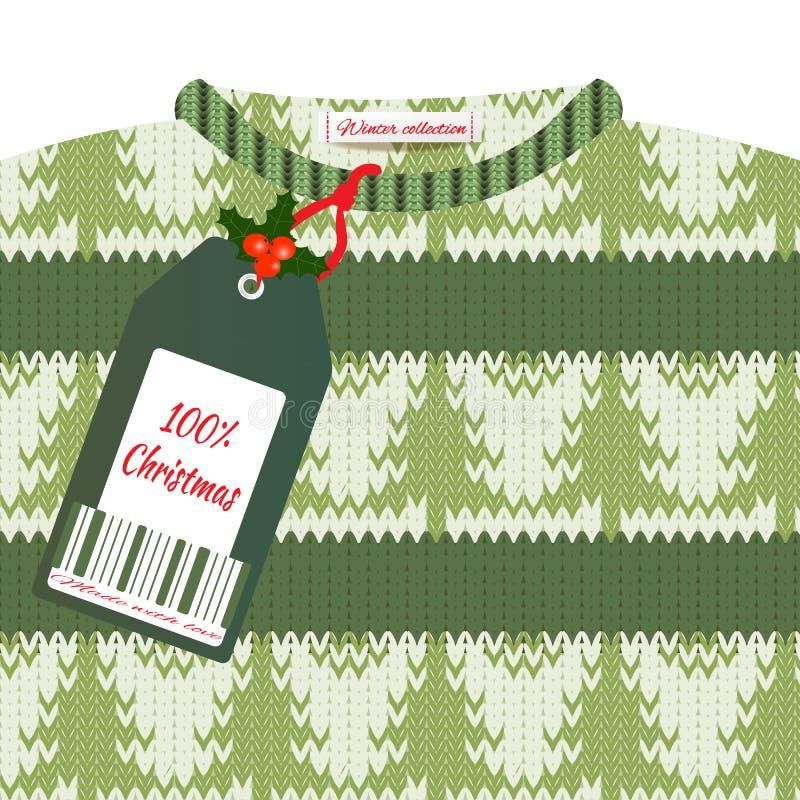 Kerstkaart met een groen gebreid sweater en een prijskaartje stock foto