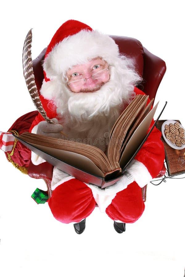 Kerstman die in boek schrijven royalty-vrije stock foto's