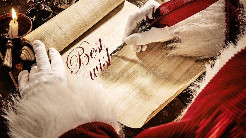 Kerstman die een Kerstmisgroet schrijven - Beste wensen stock foto