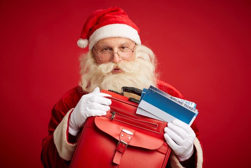 Kerstman die gaan reizen royalty-vrije stock afbeeldingen