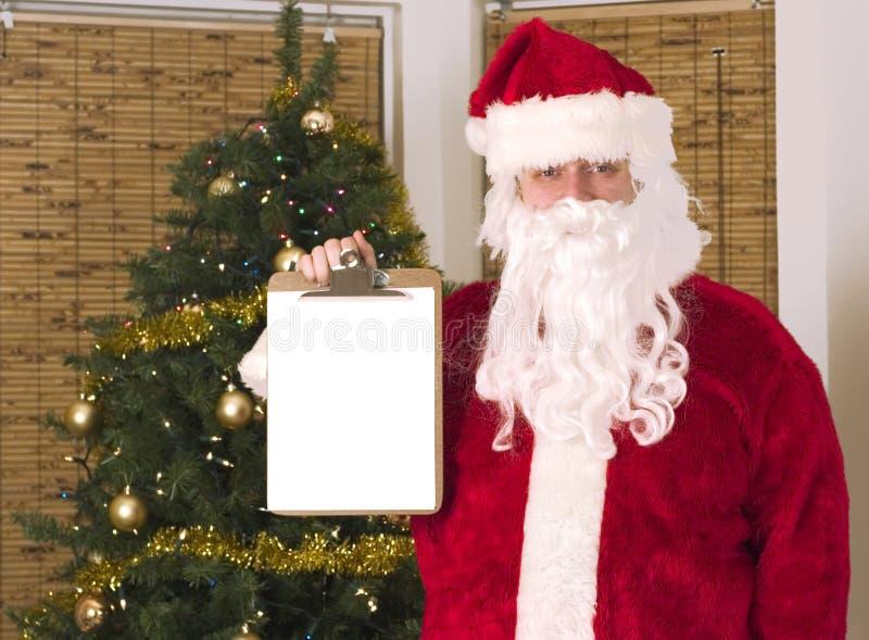 Kerstman die lijst voor uw tekst houden royalty-vrije stock foto