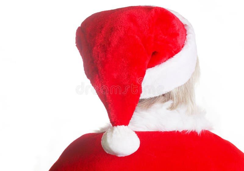 Kerstman die zijn hoed dragen stock fotografie