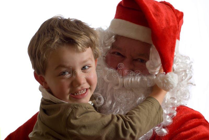 Kerstman en jonge jongen royalty-vrije stock foto