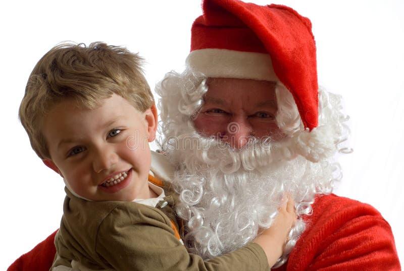 Kerstman en jonge jongen stock foto's