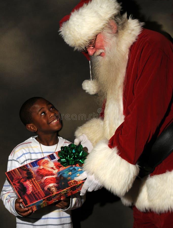 Kerstman en Little Boy royalty-vrije stock afbeelding