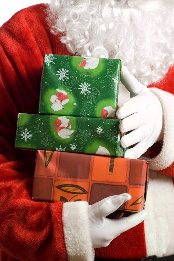 Kerstman met verpakt stelt voor stock foto