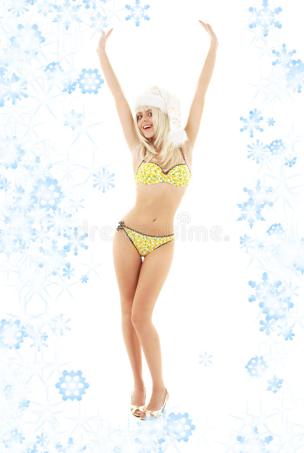 Kerstmanhelper blond op hoge hielen met sneeuwvlokken royalty-vrije stock foto's