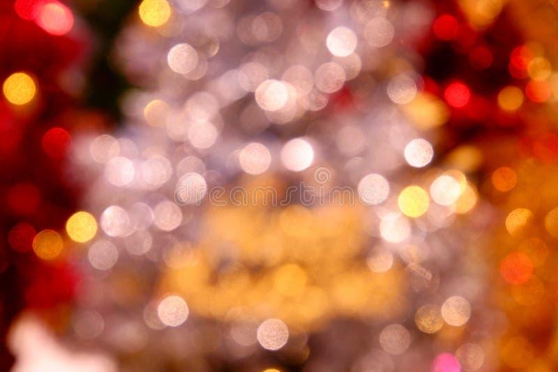 Kerstmis De gelukkige achtergrond van het Nieuwjaar De feestelijke Kerstmis abstracte achtergrond met bokeh defocused lichten royalty-vrije stock afbeeldingen