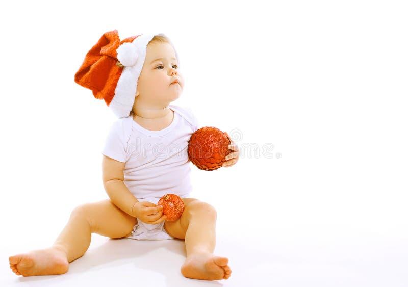 Kerstmis en mensenconcept - weinig baby in de winterhoed royalty-vrije stock foto