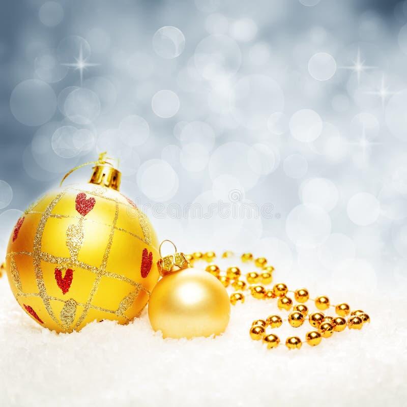 Kerstmis fonkelde Bokeh-Achtergrond met Kerstmisballen en Sneeuw royalty-vrije stock foto's