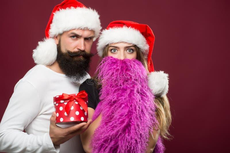 Kerstmis gebaard paar stock afbeelding