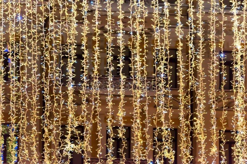 Kerstmis gele lichten voor vakantieachtergrond stock foto