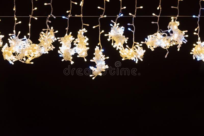 Kerstmis gele lichten voor vakantieachtergrond stock afbeelding