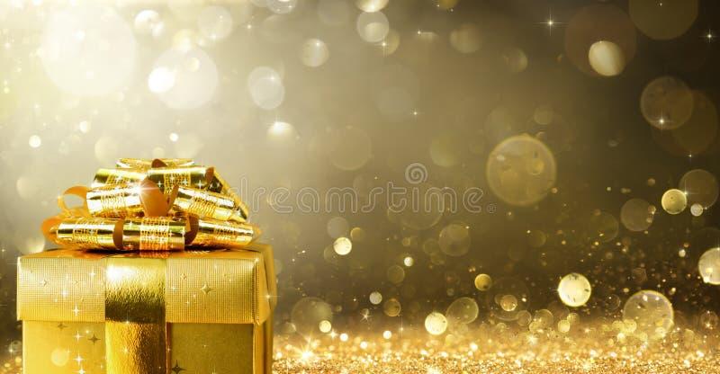 Kerstmis Huidig met het Gouden Fonkelen stock afbeeldingen