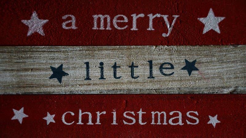 Kerstmis zeggen geschreven op houten raad stock foto's
