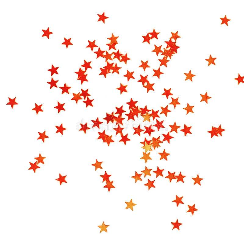 Kerstmisachtergrond met weinig glanzende rode sterren royalty-vrije stock afbeeldingen