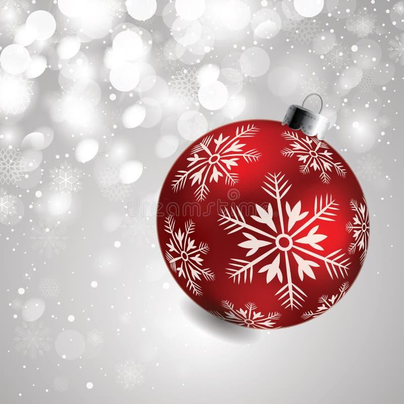 Kerstmisbol op grijze achtergrond met sneeuw stock foto