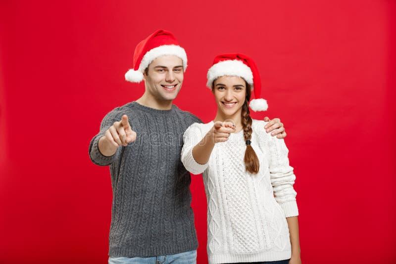 Kerstmisconcept - vinger van het portret gebruikt de mooie jonge paar aan kant goed voor presentatie of montering royalty-vrije stock afbeelding