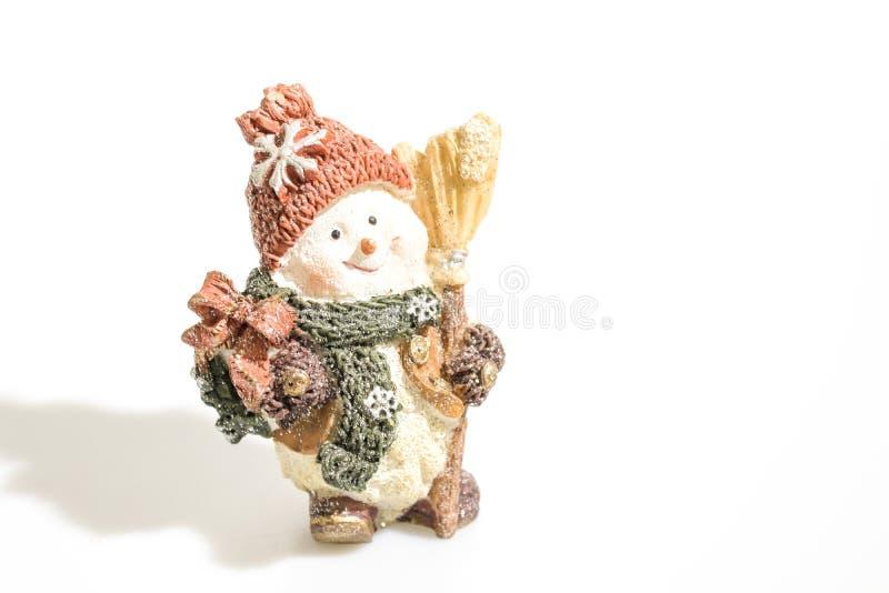 Kerstmisdecoratie, sneeuwman op een witte achtergrond wordt geïsoleerd die stock afbeeldingen