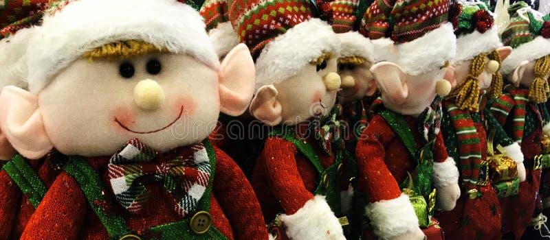 Kerstmiself, Gevulde Doll, plaiduitrustingen stock foto's