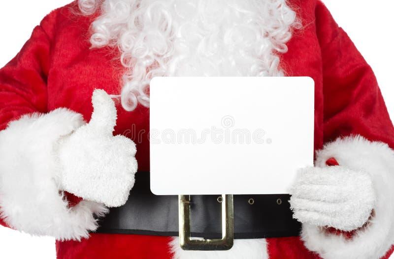 Kerstmiskerstman met een kaart stock afbeelding