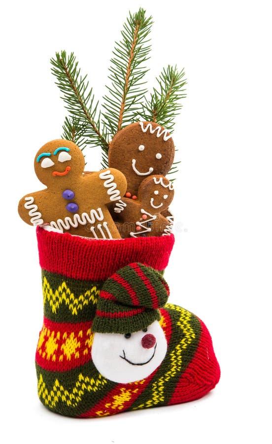 Kerstmiskoekjes in een sok royalty-vrije stock afbeeldingen