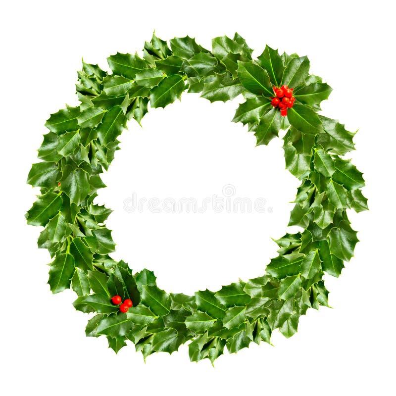 Kerstmiskroon van hulst - groen blad stock afbeelding