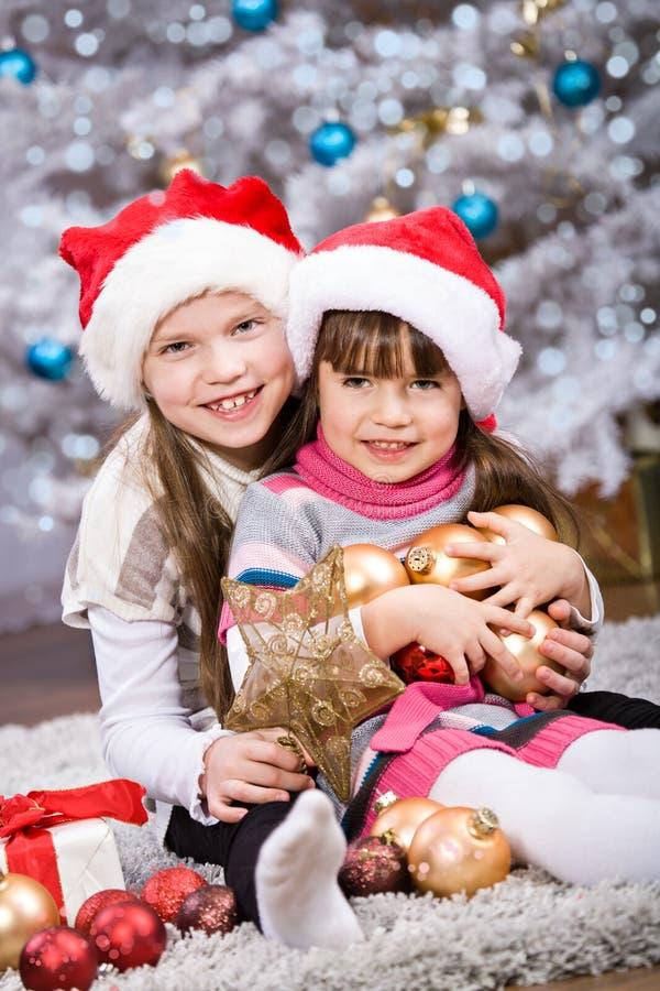 Kerstmismeisjes stock foto