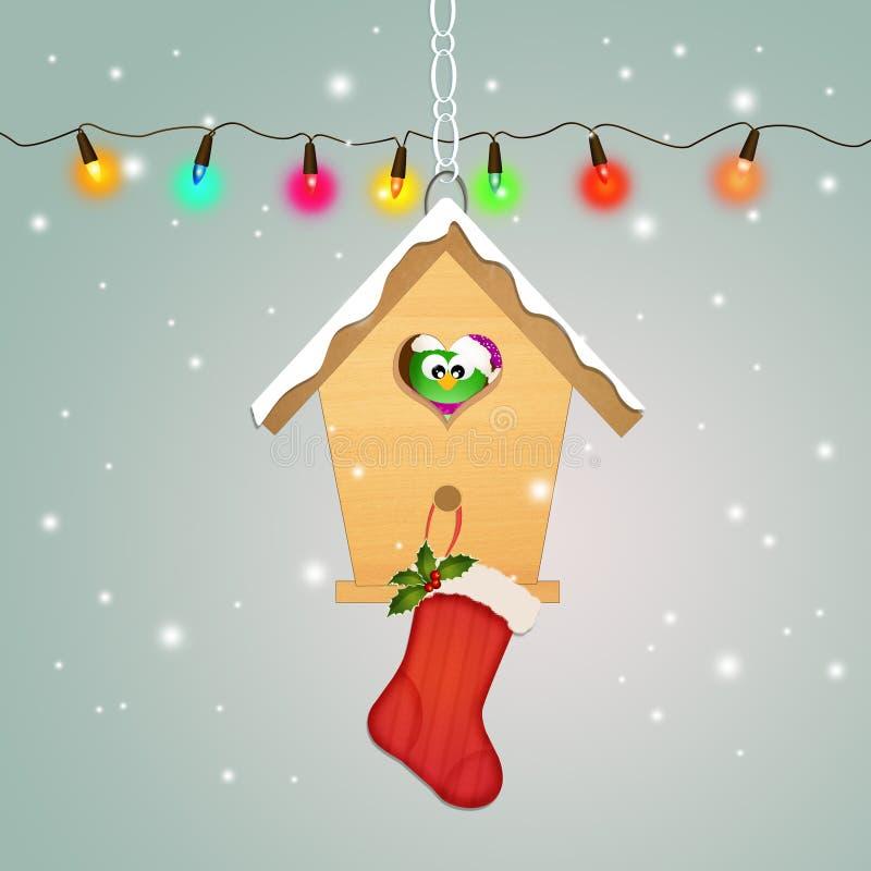 Kerstmissokken op vogelhuis royalty-vrije illustratie