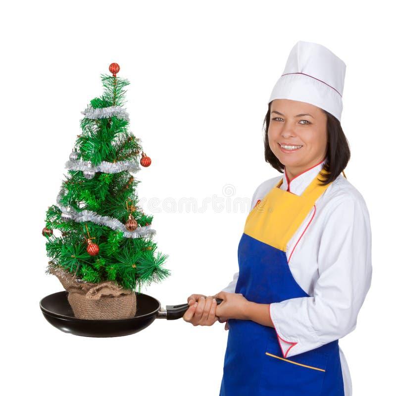 Kerstmistak en klokken Mooie Jonge Vrouwenchef-kok met Verfraaide Chr stock afbeeldingen