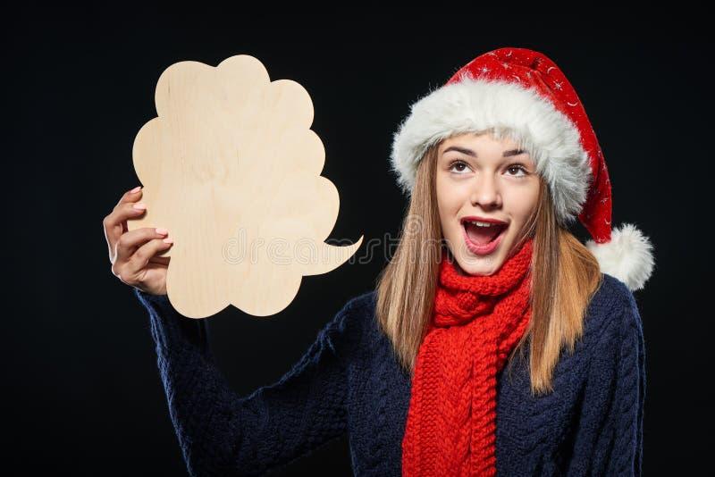 Kerstmisvrouw met gedachte bel royalty-vrije stock afbeelding