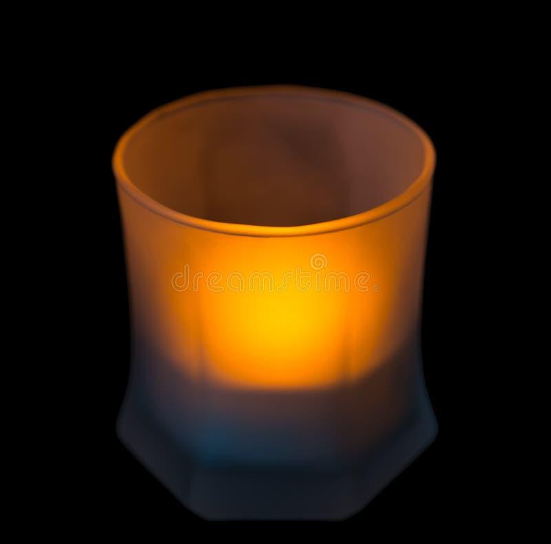 Kerze in einem Glasbecher stockfotos