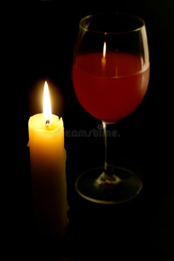 Kerze und Glas Wein lizenzfreie stockfotos