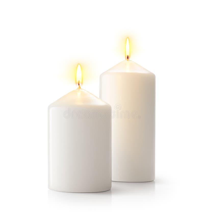 Kerzen auf weißem Hintergrund lizenzfreie stockbilder
