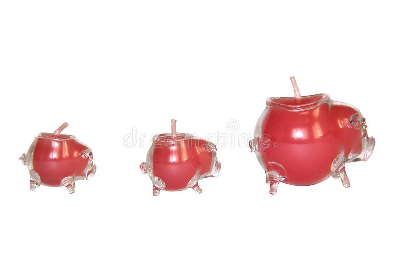 Kerzenhalter mit drei Gläsern in Form von Schweinen stockbilder