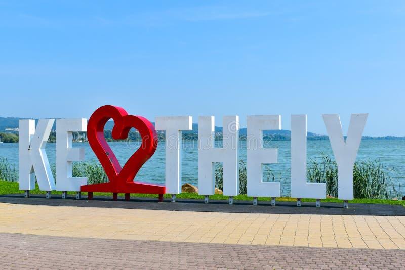 Keszthely text big letters on Balaton lake shore. Keszthely, Hungary - August 28, 2019: Keszthely text big letters on Balaton lake beach stock image