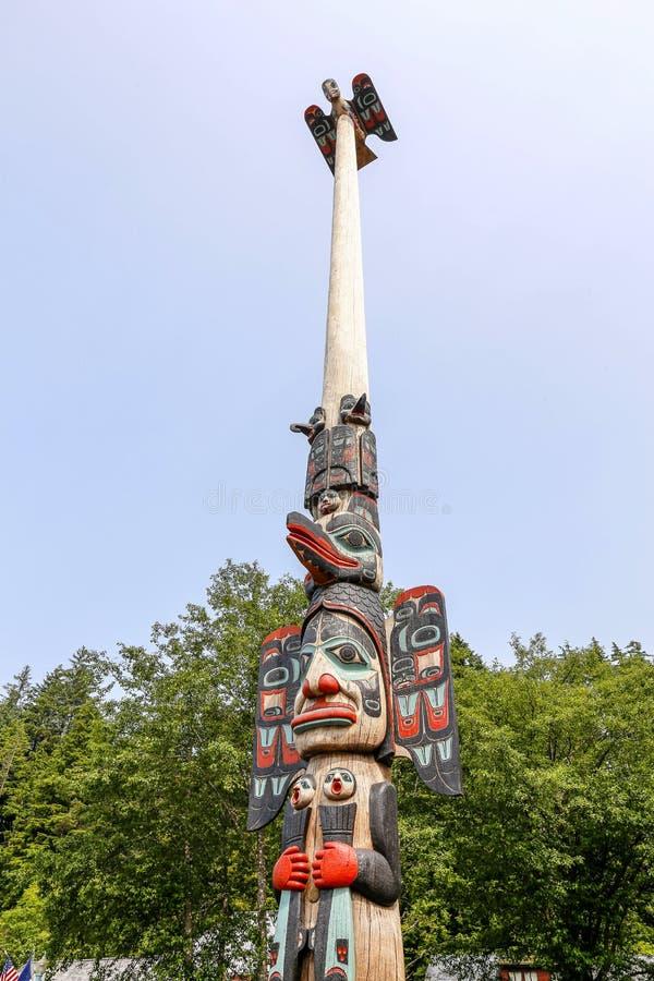 Ketchikan, Alaska, Native Alaskan Tlingit totem pole. Ketchikan, Alaska - jul 23, 2018 - The totem poles in the Saxman Native Village is the largest collection royalty free stock photo