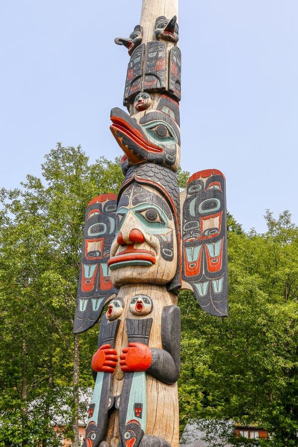 Ketchikan, Alaska, Native Alaskan Tlingit totem pole. Ketchikan, Alaska - jul 23, 2018 - The totem poles in the Saxman Native Village is the largest collection stock photography