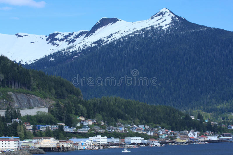 Ketchikan, Alaska, skyline with mountain. Charming, colorful homes at the base of a mountain at harborside in Ketchikan, Alaska, as viewed from a cruise ship stock images