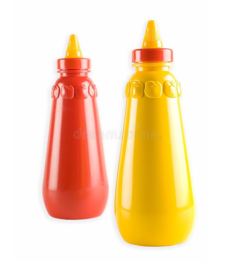 Ketchup da mostarda e de tomate fotografia de stock