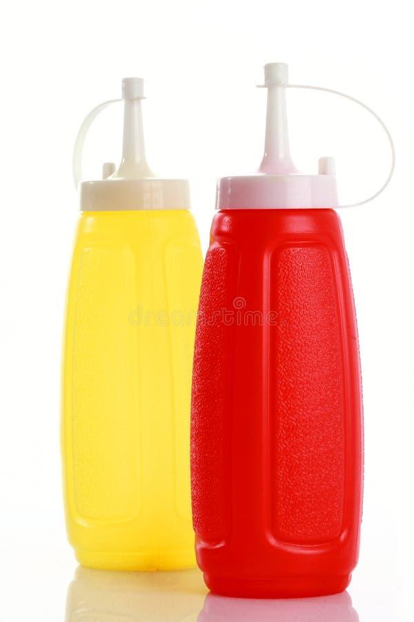 Ketchup e mostarda do frasco imagens de stock royalty free