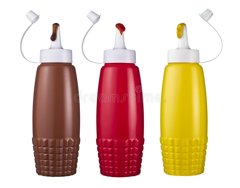 Ketchup mustard and brown sauce. Bottles isolated on a white background royalty free stock image