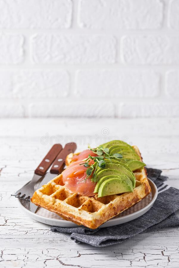 Keto cheese waffle with avocado. And salmon stock images