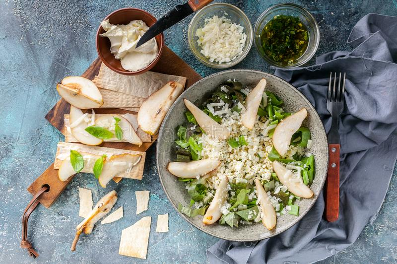 Keto diet. Salad with cottage cheese, Romano leaves, sweet pear and cheese. Cream Cheese Biscuits with Pear Slices. Top view royalty free stock photos
