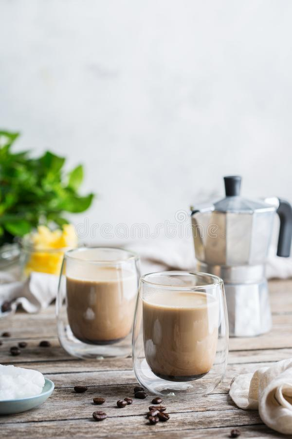 Keto, ketogenic bulletproof coffee with coconut oil and ghee butter. Healthy clean eating concept, keto, ketogenic diet, breakfast morning table. Brewed royalty free stock image