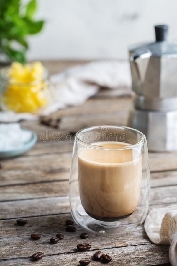 Keto, ketogenic bulletproof coffee with coconut oil and ghee butter. Healthy clean eating concept, keto, ketogenic diet, breakfast morning table. Brewed royalty free stock images