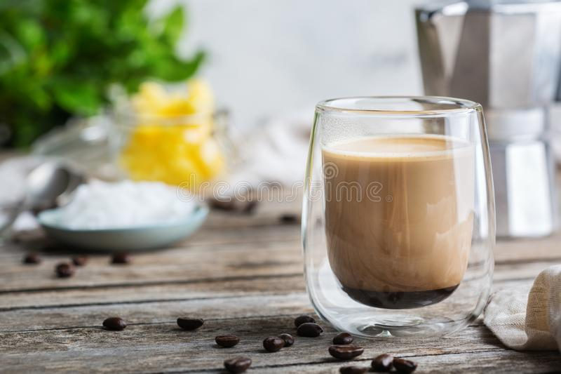 Keto, ketogenic bulletproof coffee with coconut oil and ghee butter. Healthy clean eating concept, keto, ketogenic diet, breakfast morning table. Brewed stock image