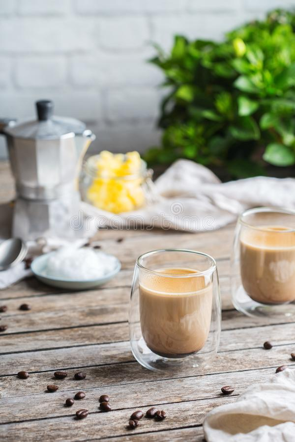 Keto, ketogenic bulletproof coffee with coconut oil and ghee butter. Healthy clean eating concept, keto, ketogenic diet, breakfast morning table. Brewed royalty free stock photo